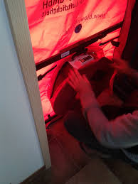 This photo shows a blower door test being set-up in a doorway. The blower door test is a precise way to determine the amount of air leakage that occurs in a home on a daily basis in order to determine whether air sealing will be recommended