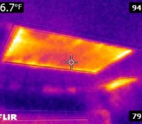 This photo shows energy loss from a standard attic hatch door